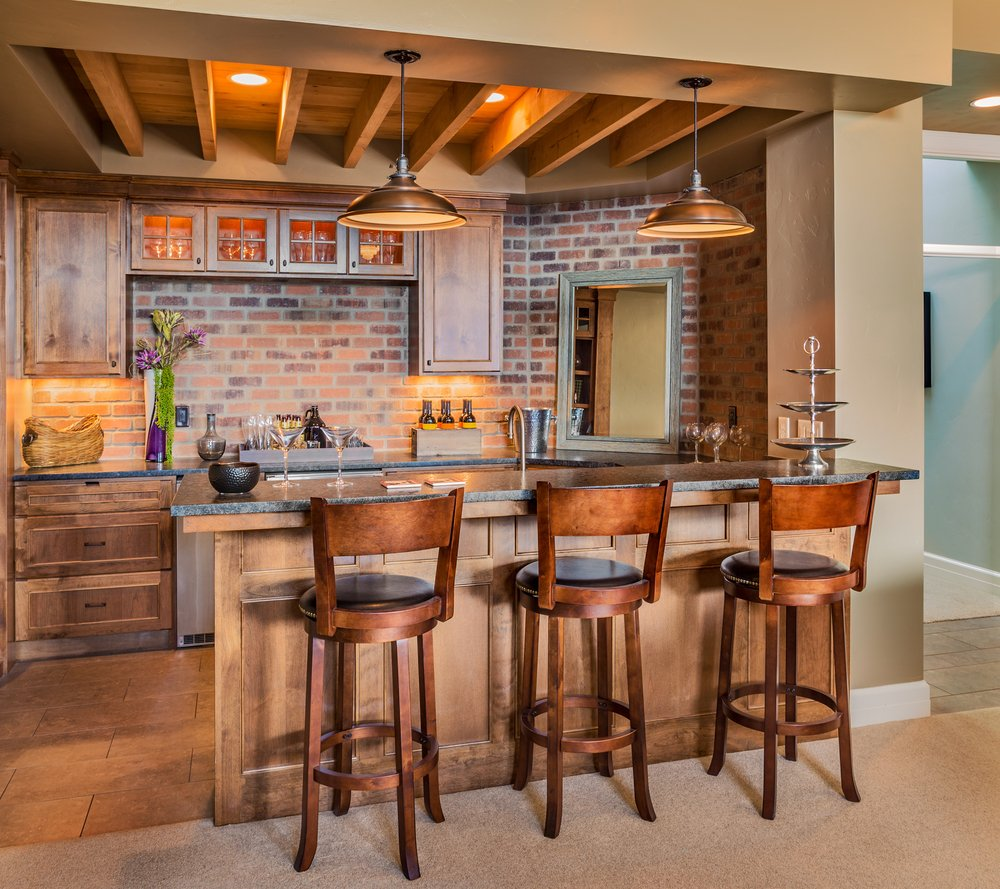 furnished blond wooden bar with high chairs