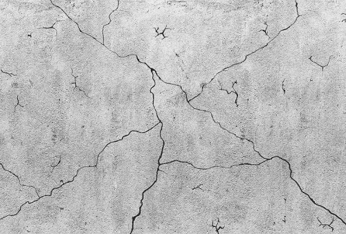 Blank grey concrete wall with cracks