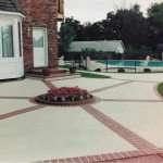 concrete-patio-brick-borders