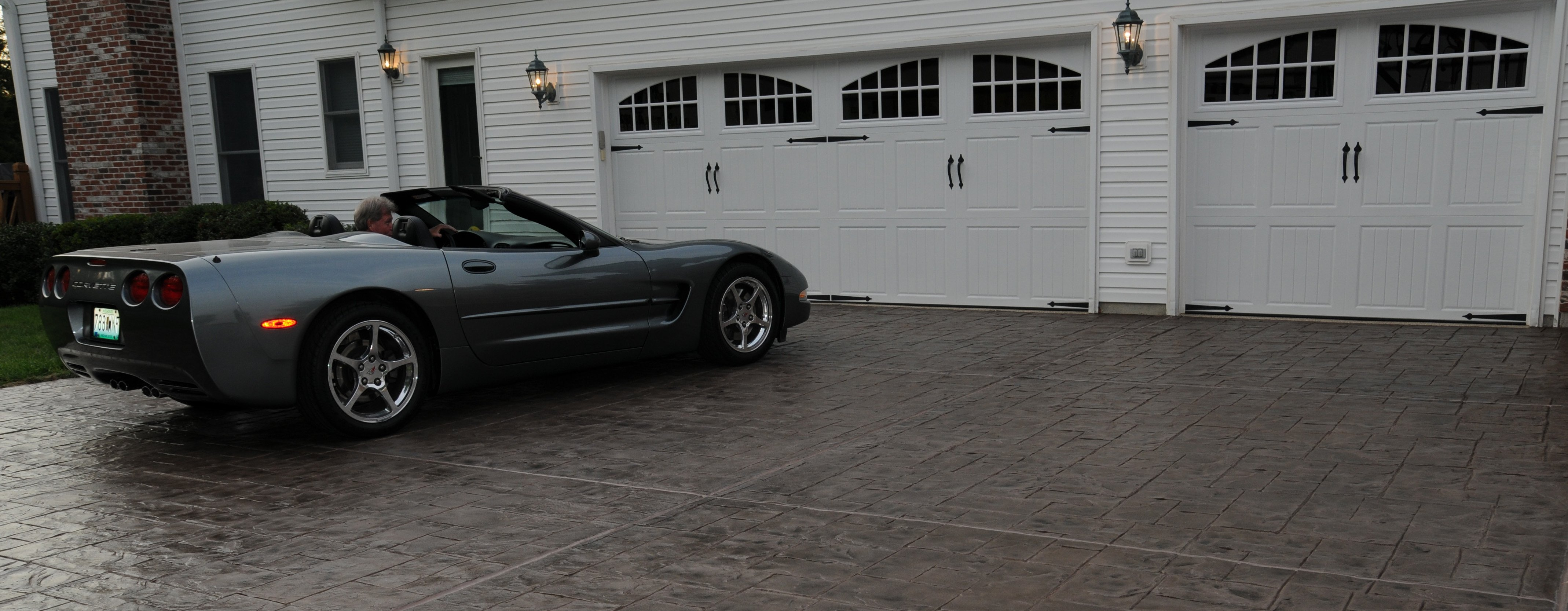 Textured driveway with a sporty car