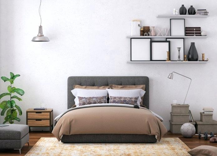 bright bedroom with beige carpet