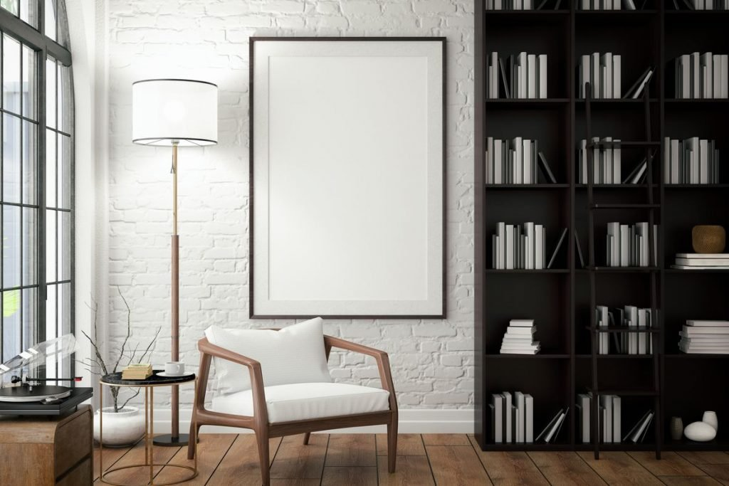 white wall with bookshelf and white-foamed wooden chair